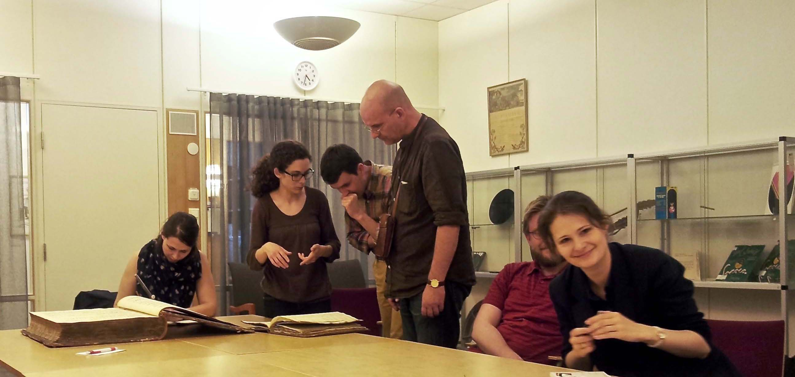 STINT project members looking at a manuscript. Photo: Ester Lebedinski